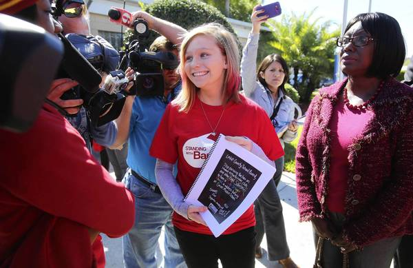 "Bayli Silberstein, an 8th-grader at Carver Middle School, with ACLU mid-Florida director Joyce Hamilton Henry, arrive at the Lake County School Board, to attend a meeting to will discuss a proposed ""Gay-Straight Alliance club,"" on February 18, 2013."
