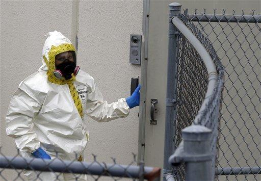 A firefighter in a protective suit walks into a government mail-screening facility in Hyattsville, Md.