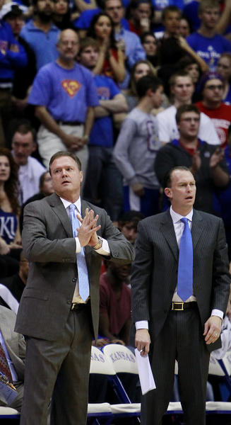 Kansas coach Bill Self and assistants Doc Sadler, left, and Joe Dooley.