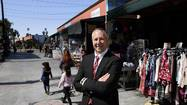 At a busy but nondescript intersection in Pacoima, a real estate developer is trying to help revive the San Fernando Valley neighborhood with an open-air market and retail complex aimed at small entrepreneurs.