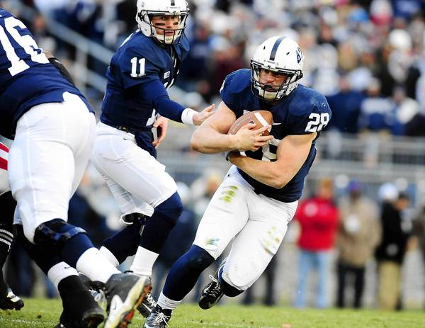 November 24, 2012; University Park, PA, USA; Penn State Nittany Lions running back Zach Zwinak (28) takes a handoff from quarterback Matt McGloin (11) during the game against the Wisconsin Badgers at Beaver Stadium.