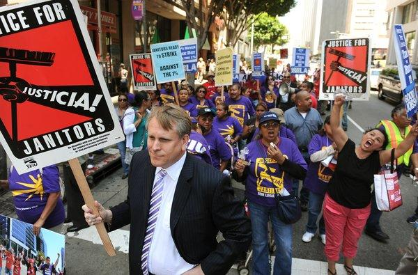 Scott Svonkin, a member of the Board of Trustees at the L.A. Community College District, joins demonstrators in downtown Los Angeles during a tax protest Tuesday.