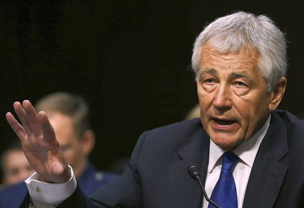 Defense Secretary Chuck Hagel said he and President Barack Obama are wary of intervening in Syria.