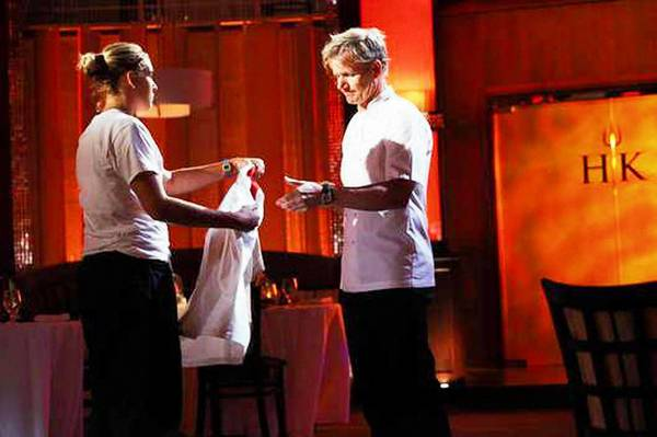 Parkland grad Jessica Lewis hands over her chef jacket to chef Gordon Ramsay on Hell's Kitchen.