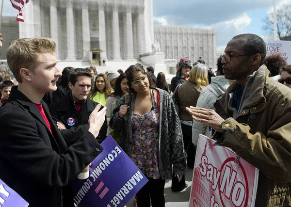 Supporters and opponents of same-sex marriage argue their points recently in front of the U.S. Supreme Court. A nation that allows robust debate on political issues leaves little room for violent extremism to take root.