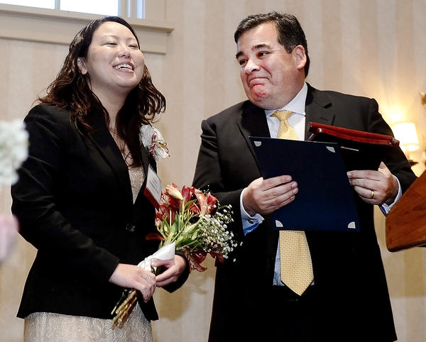 Ayako Shiga, left, was named winner of the Washington County Teacher of the Year by Superintendent Clayton Wilcox Wednesday evening at Fountain Head Country Club. Shiga teaches at Boonsboro High School.