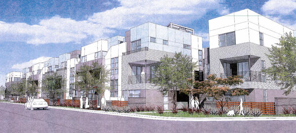 The Costa Mesa City Council on Tuesday night discussed a proposed live-work condominium project, pictured, in the city's Westside at the corner of Industrial Way and Newport Boulevard. The nearly 60-unit combined development would replace Anchor Trailer Port and a repair facility for boats and cars.
