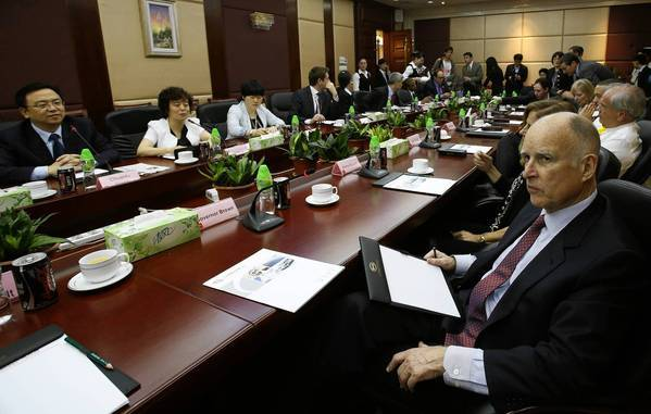 California Gov. Jerry Brown, right, meets with representatives of Chinese auto manufacturer BYD in Shenzhen, China, on Tuesday. During his trip to China, Brown repeatedly contrasted the speediness with which public works projects are completed in China with the obstacles, including environmental lawsuits, that such projects face in California.