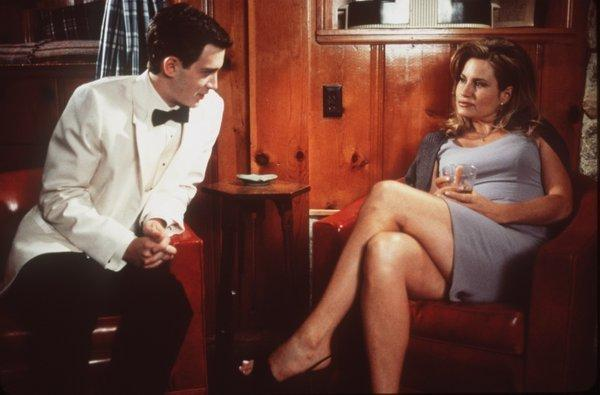 "After the prom, Paul Finch (Eddie Kaye Thomas) attempts to seduce Steve Stifler's mom (Jennifer Coolidge) in a scene from ""American Pie."""