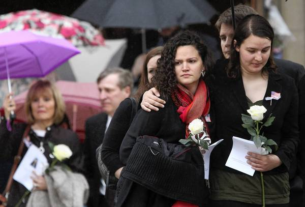 Regina and Joan Smedinghoff, right, leave after the funeral service Wednesday for their sister, Anne.
