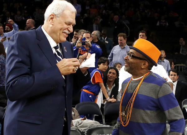 Former Lakers coach Phil Jackson and director Spike Lee talk before a ceremony to honor the 1972-73 New York Knicks championship team during the first half of an NBA game this month.