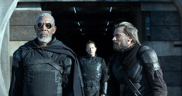Beech (Morgan Freeman, left) gives orders to Kara (Zoe Bell, center) and Sykes (Nikolaj Koster-Waldau) in Oblivion. MCT Photo