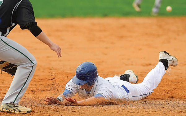 Williamsport's Riley Arnone slides safely into third base on a wild-pitch play Wednesday during the Wildcats' victory over visiting Tuscarora.