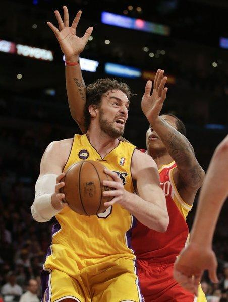 Lakers power forward Pau Gasol works his way inside against Rockets power forward Greg Smith.