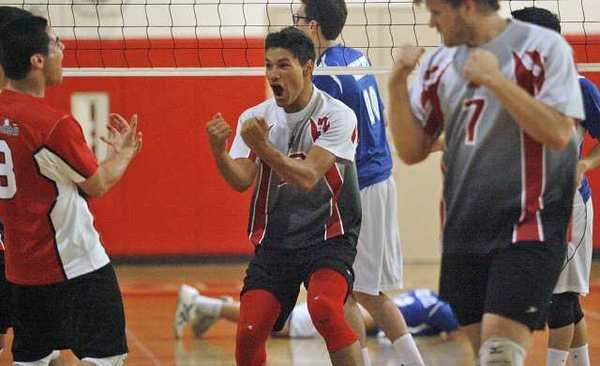 Burroughs' Daniel Jacobs, center, and his other teammates rejoice after making another point during a game against Burbank at John Burroughs High School in Burbank on Wednesday, April 17, 2013.