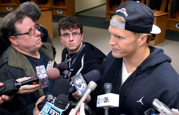 Packers linebacker Clay Matthews talks to reporters in the team's locker room after signing his new contract Wednesday.