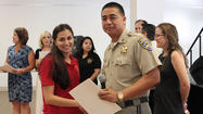 Commander Capt. Ben Nocon and Rochell Rodriguez