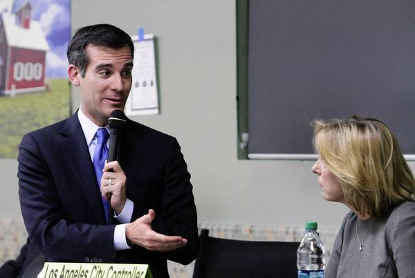 Eric Garcetti and Wendy Greuel trade barbs in Wednesday night's debate at Notre Dame High School in Sherman Oaks. The event was sponsored by the Sherman Oaks Homeowners Assn.