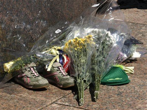 A makeshift memorial including a pair of running shoes on the campus of Boston University. BU student Lu Lingzi was one of the three who died in the bombings.