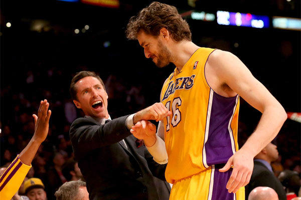 Pau Gasol is greeted by injured teammate Steve Nash in the closing seconds of the Lakers' overtime victory over Houston.