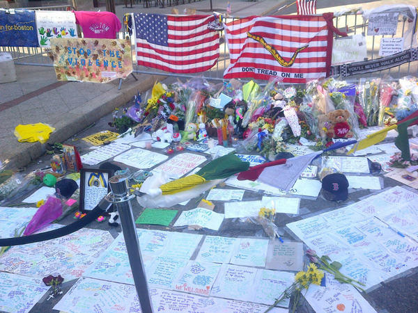 A memorial grows at the Boston Marathon finish line. Running shoes, a finisher's medal and Red Sox souvenirs were among the items left.