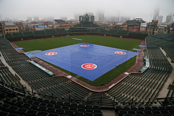 The tarp covers the infield at Wrigley Field on Wednesday. The game against the Texas Rangers was postponed.