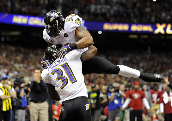 Baltimore Ravens inside linebacker Ray Lewis (52) celebrates with strong safety Bernard Pollard (31) after the San Francisco 49ers failed to convert on fourth down in the fourth quarter in Super Bowl XLVII at the Mercedes-Benz Superdome.