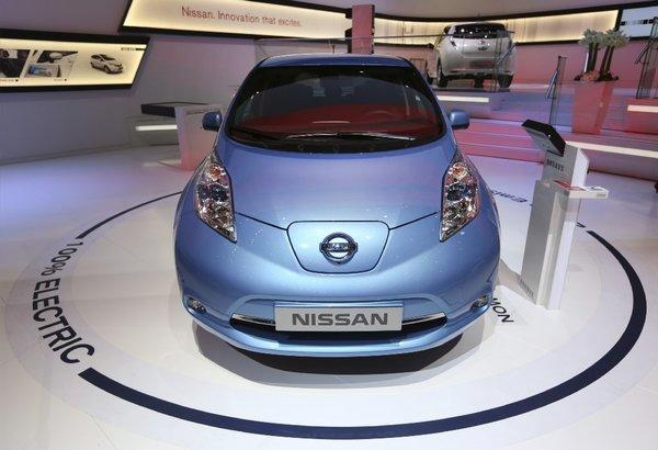 "The Nissan Leaf on display at last month's Geneva International Motor Show. The car topped Kelley Blue Book's 10 ""green"" cars list for 2013 because of a reduced sticker price and longer driving range."