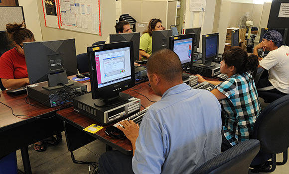 Job seekers at Rosemead center look for leads.