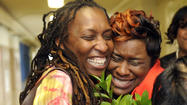 With a little yelp, lots of tears and a bouquet of flowers from her developmentally disabled twin sister, who inspired her to help students persevere, special educator Ketia C. Stokes was named Baltimore City's 2013 Teacher of the Year.