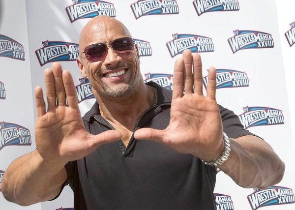 "Dwayne Johnson, 40, flashes a ""U"" in honor of his football playing days at the University of Miami."