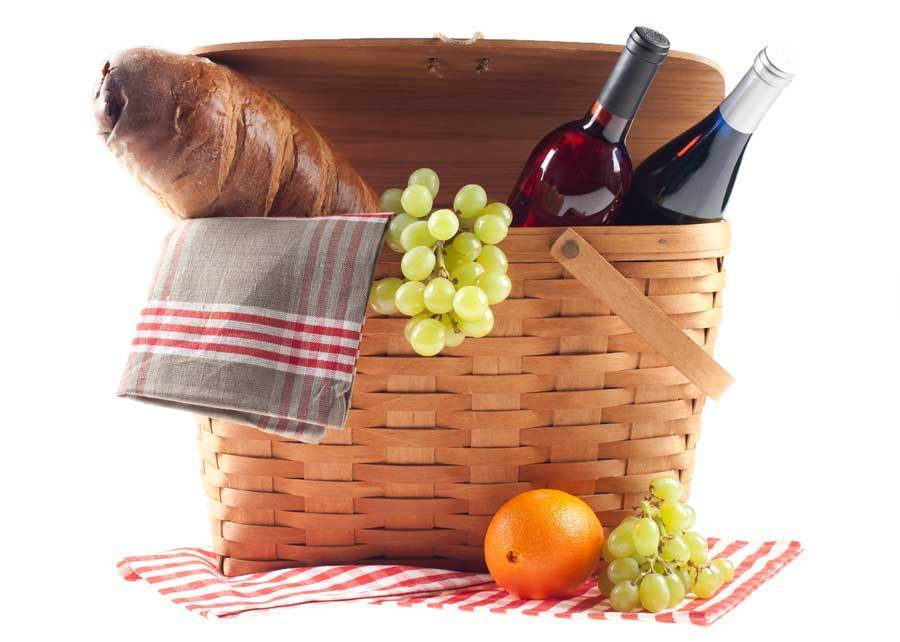 Picnic basket packed with Vienna bread from Groll's Bakery, San Cosmo wine from Mount Felix Vineyard and Winery and Riesling wine from Legends Vineyard.