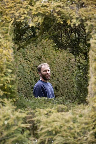 Tyler Diehl, head of gardens at Ladew Topiary Gardens in Monkton, poses for a portrait