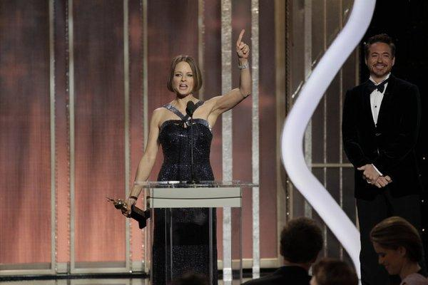 Jodie Foster accepts the Cecil B. DeMille Award at this year's Golden Globe ceremony. Robert Downey Jr. stands at right.