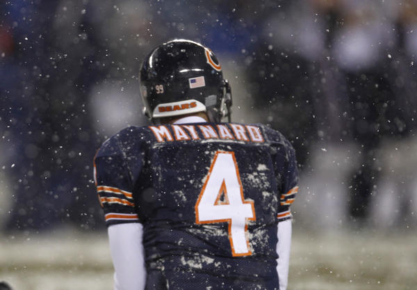 Chicago Bears punter Brad Maynard sits on the snowy turf after a third quarter punt during 36-7 loss to New England Patriots at Soldier Field on December 12, 2010.