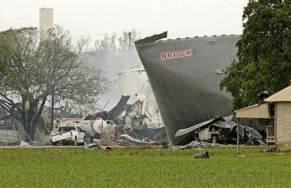 Mangled metal and crushed vehicles at the blast site of the fertilizer company Thursday in West, Texas.