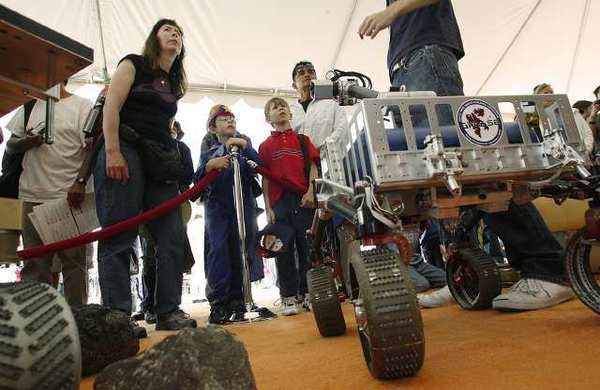 "A JPL Open House in 2010 was themed ""Worlds Beyond"" and featured displays from numerous space missions, JPL's next space craft bound for Mars, and a number of other exhibits."