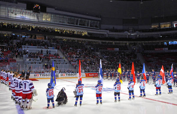 Russian President Vladimir Putin, second from the left in the background on the ice, attends the opening ceremony of the Ice Hockey U18 World Championships before a U.S.-Russian game in Sochi, Russia.