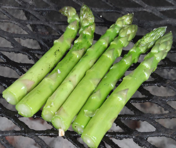 May is the time to buy local asparagus. Use some olive oil, salt and pepper and put it on the grill.