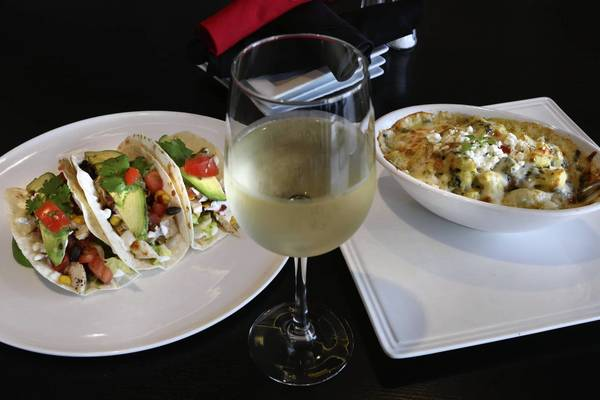Chicken tacos and Popeye mac at Matilda's on Park, a new Winter Park sports bar.