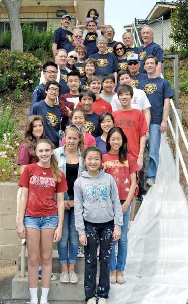 Dozens of volunteers paint rooms and rails at the Crescenta- Caada YMCA. Pictured here, left to right from the bottom row to the top: Katherine Simone, Connie Park, Erin Jones, Kate Decker, Raina Chen,Gloria Lee, Caitie Kang, Ben Blanco, Ciolin Suehiro, Adam Oler, Connor Schultz, Jason Brown, Mathew Lim, David Jin and Kiwanis Builders Club Advisor Bryon Schwartz.. .Members of the Noon Kiwanis standing behind the students, left to right are: Chuck Terhune, Mary Gant, Petty Touchstone, Clyde Hemphill, Linda Magarian, Kyle Hara and his 4-year old daughter Brylee, Stewart Lee, Mary Ann Berkuta, YMCA Board member and Kiwanian Chris Motte, Bill Scherkey, Club President Jim Phillips, Bill Koury, and Nick Berkuta.