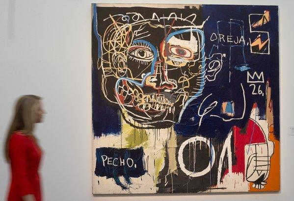 "Jean-Michel Basquiat's ""Untitled (Pecho/Oreja)"" on display at Sotheby's auction house in London."