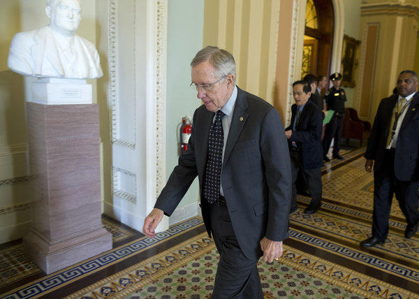Senate Majority Leader Harry Reid leaves a caucus on Capitol Hill. Reid on Thursday announced that gun control legislation would be tabled for the time being.