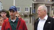 Standing at the edge of a flooded Elmhurst street, Illinois Governor Pat Quinn said Thursday he declared Illinois in a state of emergency and state agencies were prepared to provide assistance to local governments.