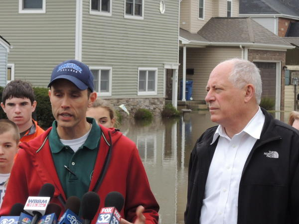 Governor Quinn and Elmhurst city manager James Grabowski speak in front of flooded houses on South Washington Street.