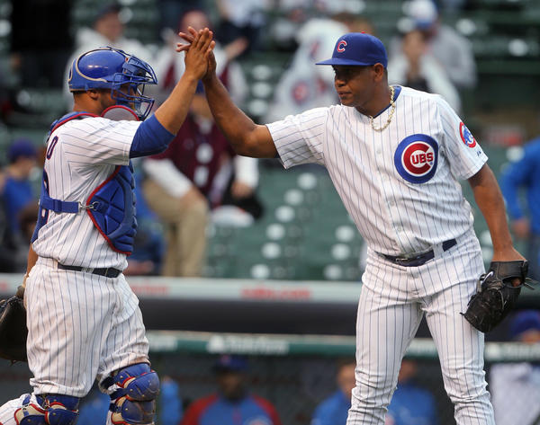 Cubs catcher Welington Castillo and pitcher Carlos Marmol celebrate the 6-2 in over the Texas Rangers on Thursday.