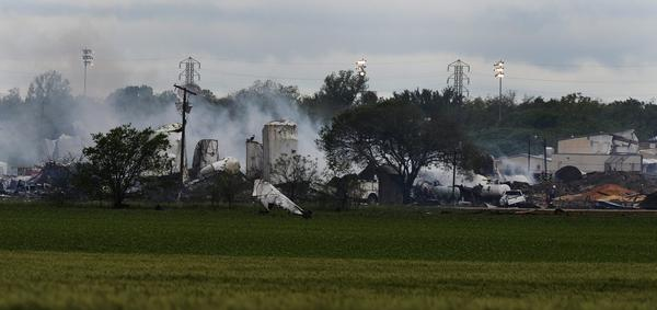 A general view of the remains of a fertilizer plant and other buildings and vehicles after the plant exploded Wednesday night in West, Texas.