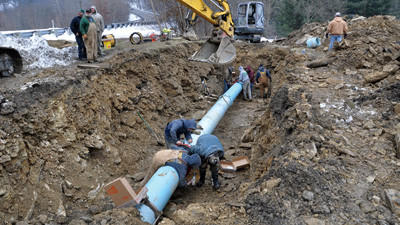 One of the Que pipeline breaks along Route 985 earlier this year.