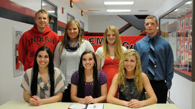 Front row from left: Carly Baer, Lyndy Baer and Kelsey Smith; back row: Dillon Boyer, Deanna Binnie, Allyson Lonas and Josh Burns, all students at Conemaugh Township, announce their intent to play collegiate sports Thursday.