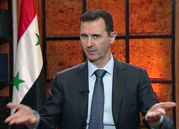 In this image from video broadcast on Syrian state television Wednesday, President Bashar Assad speaks during an interview.